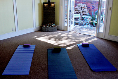 Yoga room with 3 yoga mats and door open at 7 Summit Pathways