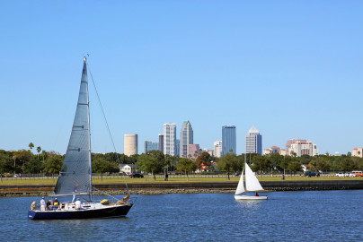 Sailboats with city skyline in background
