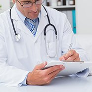 doctor writing a prescription on clipboard