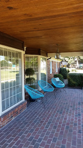 front porch with blue chairs