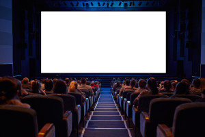 inside movie theater with white screen