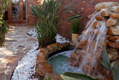 Outdoor garden waterfall and walkway at 7 Summit Pathways