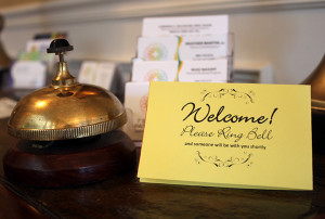 Welcome sign on counter with bell