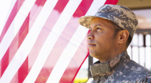 man in military in front of American flag