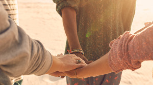 recovery support group holding hands