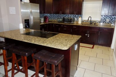 A modern kitchen with tile flooring