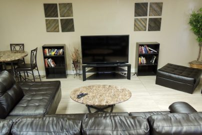 inside common area with couches and tv