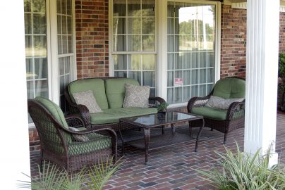 Front porch with brick floor and three lounge chairs