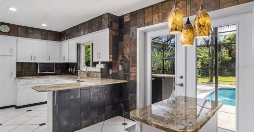 Kitchen with the View of the Pool